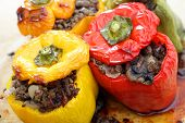 Colourful bell peppers or capsicums stuffed with a filling of ground beef, mushroom, onion and celer
