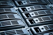 close-up of hard drives sorted in a rack poster