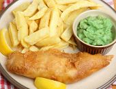 Cod fish, chips and mushy peas.