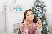 Hope Concept. Dreamy Baby Christmas Wish. Making Wish. Waiting For Santa Claus. Adorable Girl Making poster