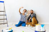 Young Happy Family Married Couple Dreams Of Renovating  House And Planning A Design Project. poster