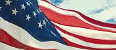 American National Holiday. Us Flag With American Stars, Stripes And National Colors. Sky Background. poster