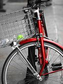 An Old And Red  Bicycle In The Street