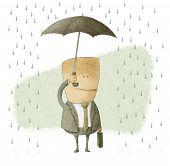 happy businessman under an umbrella