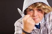 violent teen boy holding a knife