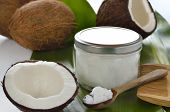 stock photo of flesh  - Coconut oil in a glass jar - JPG