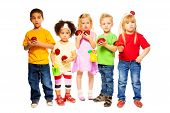 picture of water bug  - Five little kids boys and girls blond and black standing together in a line with spring topic props with watering can and green branches and ladybugs - JPG