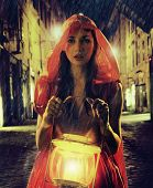 Mystical young lady holding a lantern
