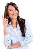 Business woman pointing an idea and smiling - isolated over white