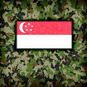 stock photo of ami  - Amy camouflage uniform with flag on it Singapore - JPG