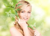 picture of woman with sprout over green background