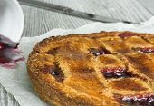 image of linzer  - Homemade traditional Austrian Linzer tart with blackcurrant jam - JPG