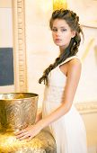 Luxurious Posh Brunette In White Dress. Oriental Antique Golden Decor