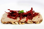 foto of canard  - Piece of dark bread with live pate and beetroot julienne on top - JPG