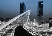 Nightview of Zubizuri bridge and Isozaki towers in Bilbao, Spain