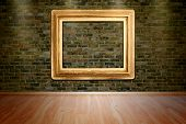 Gold Picture Frame On Brick Wall And Wood Floor