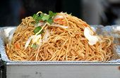 stock photo of chinese parsley  - Fried noodles with cabbage and parsley a common Chinese dish - JPG