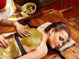 image of panchakarma  - Young woman having body Ayurveda spa massage - JPG