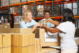 image of tin man  - Volunteers Collecting Food Donations In Warehouse - JPG