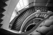 Spiral Stairs With Balusters. Abstract Classical Architecture Dark Interior Monochrome Fragment