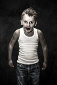 stock photo of serial killer  - Vampire child in the shadow Halloween Collection - JPG
