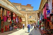 JERUSALEM - AUGUST 21: Bazaar in Old City offers middle east traditional products and souvenirs. It