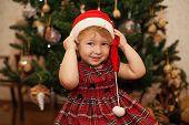 Smiling little girl in christmas hat
