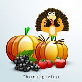 Happy Thanksgiving Day background with fruits, vegetables and smiling turkey bird on blue background.