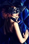 Beautiful elegant woman in carnival mask.