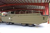 image of amphibious  - vintage military amphibious craft in a shed - JPG