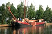 pic of flatboat  - Traditional wooden flat boat with crew  - JPG