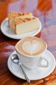 pic of latte  - Cup of latte coffee with cake on wood table - JPG