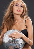 party, entertainment and nightlife concept - woman in black lingerie with disco ball