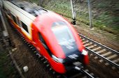 stock photo of polonia  - Commuter Railway train in motion - JPG