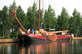 stock photo of flatboat  - Traditional wooden flat boat with crew  - JPG