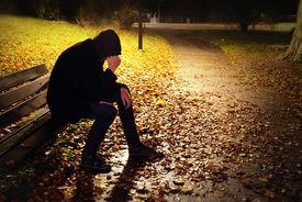 stock photo of saddening  - Depressed Man On Bench - JPG