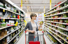 pic of grocery cart  - pretty woman with a cart shopping and choosing goods at the supermarket - JPG