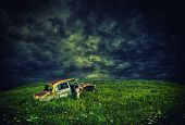 Abandoned rustic car on the hill