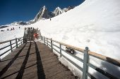 Wooden Stair And Traveler On Jade Dragon Snow Mountain,lijiang,yunan,southwestern China.