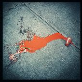 picture of discard  - Instagram style image of a discarded smoothie on the city sidewalk - JPG