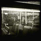 Instagram style image of an empty bus during a rain storm