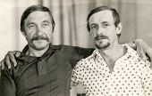 BELCHATOW, POLAND, JUNE 21, 1985: Vintage photo of two men with mustache hugging