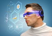 business and future technology concept - handsome man with futuristic glasses