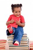African little girl sitting on many books isolated on a white background