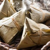 Asian Chinese rice dumplings on basket, fresh with hot steamed smoke