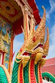 Golden Naga, Thai Mythological Character, As Part Of Beautiful Architecture  Of Chalong Temple, Phuk