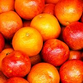 Red Orange Fruit Background. Pile Of Orange Fruit In A Market Stall. Food Background.