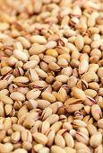 Pistachios Background Close Up. Pistachio Nuts Pile On A Market.