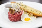 pic of tartar  - Close up of tartare beef with fried egg - JPG