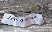 Word Less Is More On Torned Paper